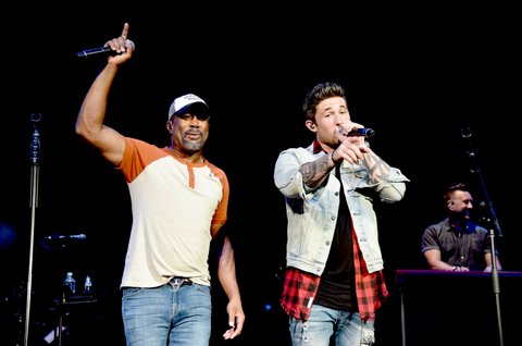 NASHVILLE, TN - JUNE 05:  Musician Darius Rucker (L) and Michael Ray (R)perform onstage during the 8th annual Darius & Friends concert to benefit St. Jude's Children's Research Hospital held at the Ryman Auditorium on June 5, 2017 in Nashville, Tennessee.  (Photo by John Shearer/Getty Images)