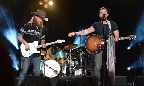 NASHVILLE, TN - JUNE 11:  (EDITORIAL USE ONLY)  Singer/songwriters John Osborne (L) and TJ Osborne of the Brothers Osborne perform at Nissan Stadium during day 4 of the 2017 CMA Music Festival on June 11, 2017 in Nashville, Tennessee.  (Photo by Mindy Small/FilmMagic)