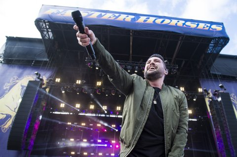 BROOKLYN, MI - JULY 22:  Shay Mooney of Dan + Shay performs during Faster Horses Festival at Michigan International Speedway on July 22, 2017 in Brooklyn, Michigan.  (Photo by Erika Goldring/WireImage)