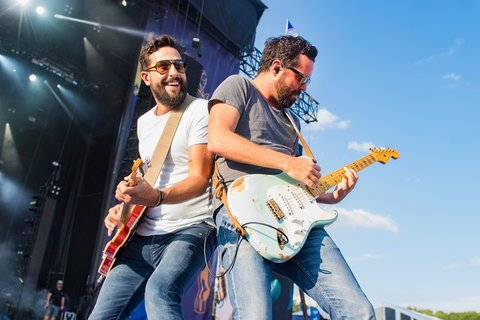 BROOKLYN, MI - JULY 23:  Matthew Ramsey (L) and Brad Tursi of Old Dominion perform during Faster Horses Festival at Michigan International Speedway on July 23, 2017 in Brooklyn, Michigan.  (Photo by Erika Goldring/WireImage)