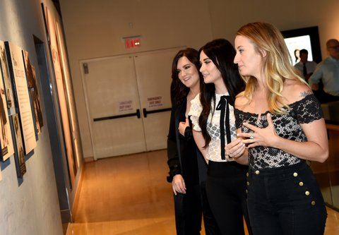 NASHVILLE, TN - AUGUST 22:  Brandy Clark, Kacey Musgraves, and Margo Price view the Loretta Lynn: Blue Kentucky Girl exhibit at Country Music Hall of Fame and Museum on August 22, 2017 in Nashville, Tennessee.  (Photo by Rick Diamond/Getty Images for Country Music Hall Of Fame & Museum)