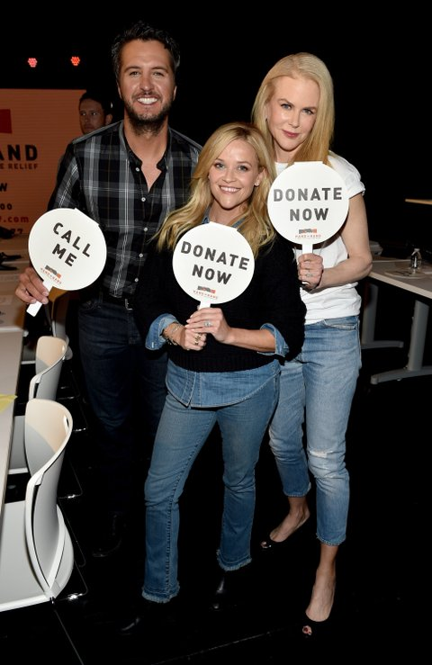 NASHVILLE, TN - SEPTEMBER 12:  In this handout photo provided by Hand in Hand, Luke Bryan, Reese Witherspoon, and Nicole Kidman attend Hand in Hand: A Benefit for Hurricane Relief at the Grand Ole Opry House on September 12, 2017 in Nashville, Tennessee.  (Photo by John Shearer/Hand in Hand/Getty Images)