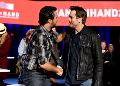 NASHVILLE, TN - SEPTEMBER 12:  In this handout photo provided by Hand in Hand, Luke Bryan and Charles Esten attend Hand in Hand: A Benefit for Hurricane Relief at the Grand Ole Opry House on September 12, 2017 in Nashville, Tennessee.  (Photo by John Shearer/Hand in Hand/Getty Images)