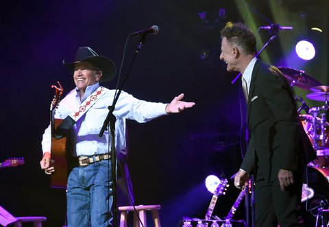 SAN ANTONIO, TX - SEPTEMBER 12:  George Strait (L) and Lyle Lovett perform onstage during George Strait's Hand in Hand Texas benefit concert; Strait and special guests Miranda Lambert, Chris Stapleton, Lyle Lovett and Robert Early Keen perform in concert at the Majestic Theatre on September 12, 2017 in San Antonio, Texas.  (Photo by Rick Diamond/Getty Images for George Strait)