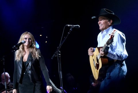 SAN ANTONIO, TX - SEPTEMBER 12:  Miranda Lambert (L) and George Strait perform onstage during George Strait's Hand in Hand Texas benefit concert; Strait and special guests Miranda Lambert, Chris Stapleton, Lyle Lovett and Robert Early Keen perform in concert at the Majestic Theatre on September 12, 2017 in San Antonio, Texas.  (Photo by Rick Diamond/Getty Images for George Strait)