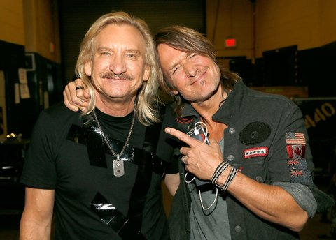 FAIRFAX, VA - SEPTEMBER 20:  (EXCLUSIVE COVERAGE) Joe Walsh (L) and Keith Urban backstage the VetsAid Charity Benefit Concert at Eagle Bank Arena on September 20, 2017 in Fairfax, Virginia. VetsAid is a foundation created by Walsh to support veterans and their families.  (Photo by Paul Morigi/Getty Images)