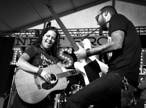 LAS VEGAS, NV - SEPTEMBER 29:  (EDITORS NOTE: Image has been converted to black and white.) Recording artist Ashley McBryde (L) and bassist Christian Sancho perform during the Route 91 Harvest country music festival at the Las Vegas Village on September 29, 2017 in Las Vegas, Nevada.  (Photo by David Becker/Getty Images)