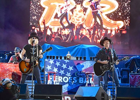 LAS VEGAS, NV - OCTOBER 01:  Recording artists Big Kenny (L) and John Rich of Big & Rich perform during the Route 91 Harvest country music festival at the Las Vegas Village on October 1, 2017 in Las Vegas, Nevada.  (Photo by Mindy Small/FilmMagic)