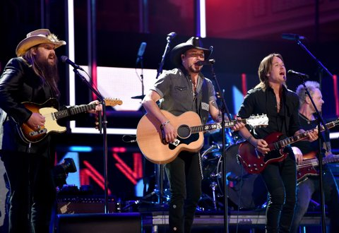 NASHVILLE, TN - OCTOBER 18:  (L-R) Honorees Chris Stapleton, Jason Aldean and Keith Urban perform onstage at the 2017 CMT Artists Of The Year on October 18, 2017 in Nashville, Tennessee. (Photo by Rick Diamond/Getty Images for CMT)