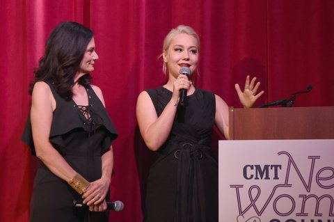 NASHVILLE, TN - NOVEMBER 07:  Hosts Senior Vice President of Music Strategy for CMT Leslie Fram (L) and Raelynn (R) speak onstage during the 2017 CMT Next Women Of Country Celebration at City Winery Nashville on November 7, 2017 in Nashville, Tennessee.  (Photo by Rick Diamond/Getty Images for CMT)