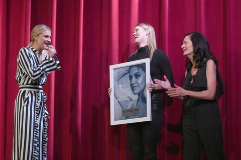 NASHVILLE, TN - NOVEMBER 07:  Kelsea Ballerini is presented the Impact Award from songwriter Nicolle Galyon and Senior Vice President of Music Strategy for CMT Leslie Fram during the 2017 CMT Next Women Of Country Celebration at City Winery Nashville on November 7, 2017 in Nashville, Tennessee.  (Photo by Rick Diamond/Getty Images for CMT)