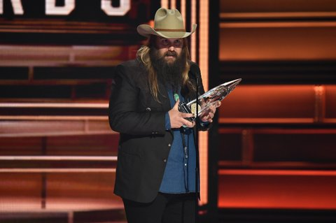 NASHVILLE, TN - NOVEMBER 08:  Chris Stapleton accepts an award onstage at the 51st annual CMA Awards at the Bridgestone Arena on November 8, 2017 in Nashville, Tennessee.  (Photo by John Shearer/WireImage)