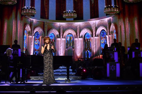 NASHVILLE, TN - NOVEMBER 14:  Recording Artist Reba McEntire performs on stage during the 2017 CMA Country Christmas at The Grand Ole Opry on November 14, 2017 in Nashville, Tennessee.  (Photo by Jason Davis/WireImage)