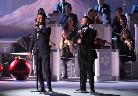 NASHVILLE, TN - NOVEMBER 14:  Recording artists Dan Smyer and Shay Mooney of Dan + Shay perform during CMA 2017 Country Christmas at The Grand Ole Opry on November 14, 2017 in Nashville, Tennessee.  (Photo by Mickey Bernal/FilmMagic)