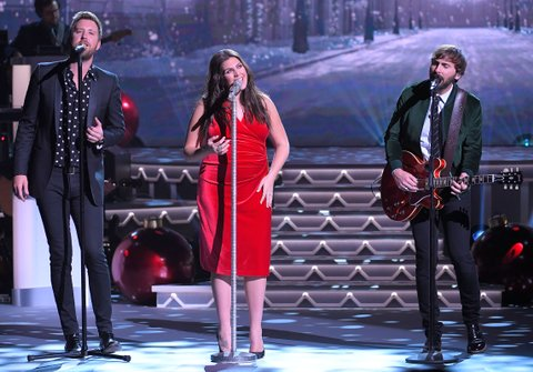 NASHVILLE, TN - NOVEMBER 14:  Recording artists Charles Kelly, Hillary Scott and Dave Haywood of Lady Antebellum perform during CMA 2017 Country Christmas at The Grand Ole Opry on November 14, 2017 in Nashville, Tennessee.  (Photo by Mickey Bernal/FilmMagic)
