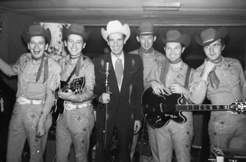 Leon Rhodes (pictured second from the right) poses with the Texas Troubadours.