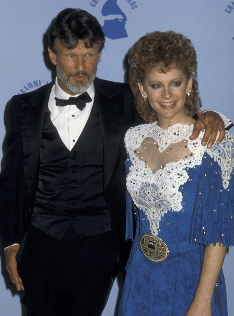 LOS ANGELES, CA - FEBRUARY 25:  Kris Kristofferson and Reba McEntire attend 28th Annual Grammy Awards on February 25, 1986 at the Shrine Auditorium in Los Angeles, California. (Photo by Ron Galella, Ltd./WireImage)