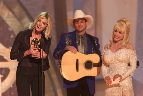 Faith Hill accepts her Grammy award for 'best country album' as presenters Brad Paisley and Dolly Parton look on during the 43rd Annual Grammy Awards at the Staples Center in Los Angeles on February 21, 2001. Photo:Dave Hogan/Getty Images